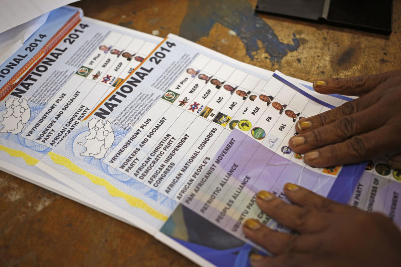 Ballots printed with names and photos of election candidates and their political parties are seen at a polling station in the township of Nyanga on the outskirts of Cape Town, South Africa, Wednesday, May 7, 2014. South Africans voted Wednesday in elections that are expected to see the ruling African National Congress return to power despite a vigorous challenge from opposition parties seeking to capitalize on discontent with corruption and economic inequality. (AP Photo/Schalk van Zuydam)