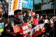 Pro-democracy protesters march during a demonstration near a flag raising ceremony on the anniversary of Hong Kong's handover to China in Hong Kong