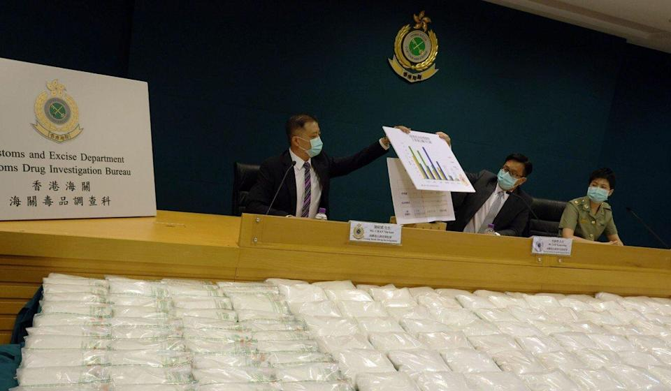 (From left) Senior customs officers Philip Chan, Lee Kam-wing and Man King-foon display the ketamine seized from the container yard in Kwai Chung. Photo: Nora Tam
