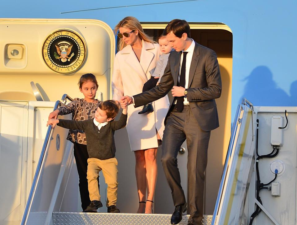 <p>Ivanka Trump departed Air Force One with her husband, Jared Kushner, and their 3 children at Palm Beach International airport in in West Palm Beach, Fla. She was wearing a sleek ivory coat, shades, and sandals. (Photo: AP Images) </p>