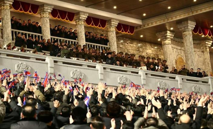 North Korean leader Kim Jong Un is cheered during a military parade celebrating the 8th Congress of the Workers' Party of Korea (WPK) in Pyongyang