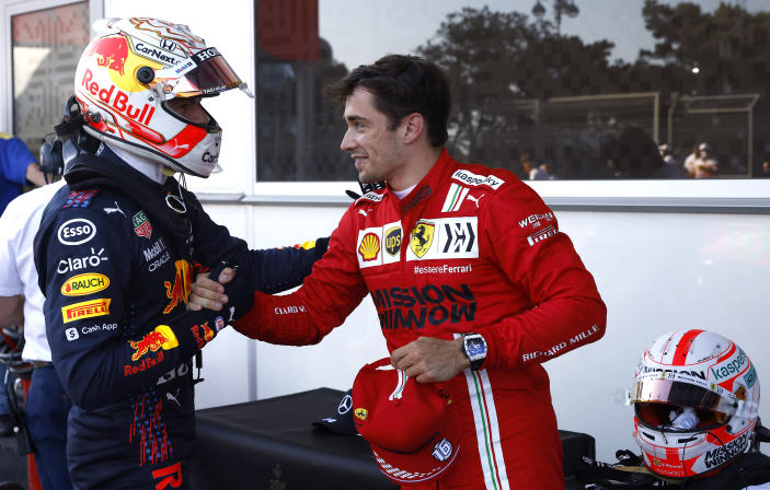 Ferrari driver Charles Leclerc of Monaco, right, is congratulated by Red Bull driver Max Verstappen of the Netherlands after taking pole position during the qualifying session at the Baku Formula One city circuit in Baku, Azerbaijan, Saturday, June 5, 2021. The Azerbaijan Formula One Grand Prix will take place on Sunday. (Maxim Shemetov, Pool via AP)