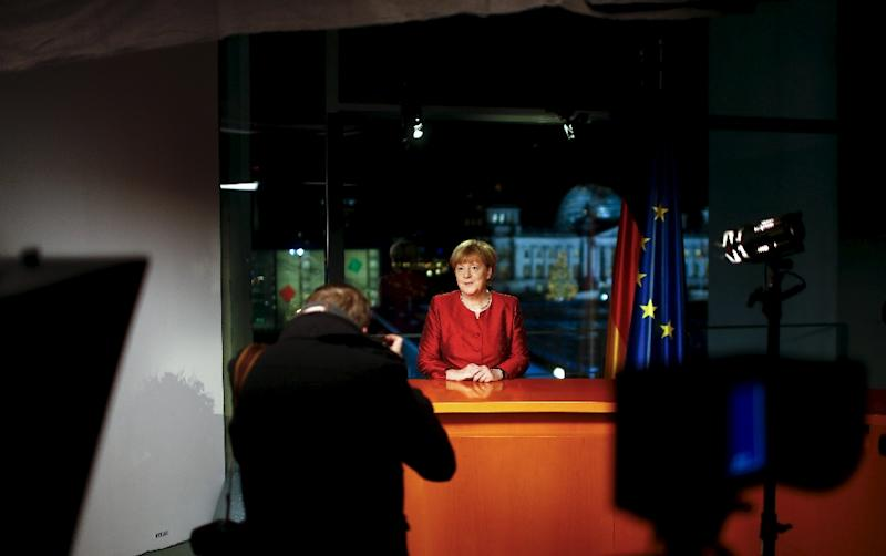 German Chancellor Angela Merkel poses after recording her New Year's speech in the Chancellery in Berlin, on December 30, 2015 (AFP Photo/Hannibal Hanschke)