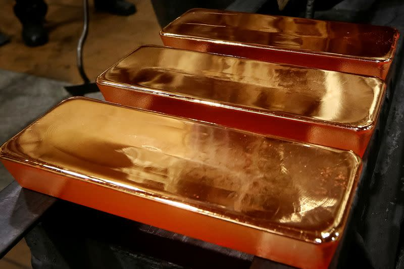 Gold falls on China tariff move, but set for a weekly gain