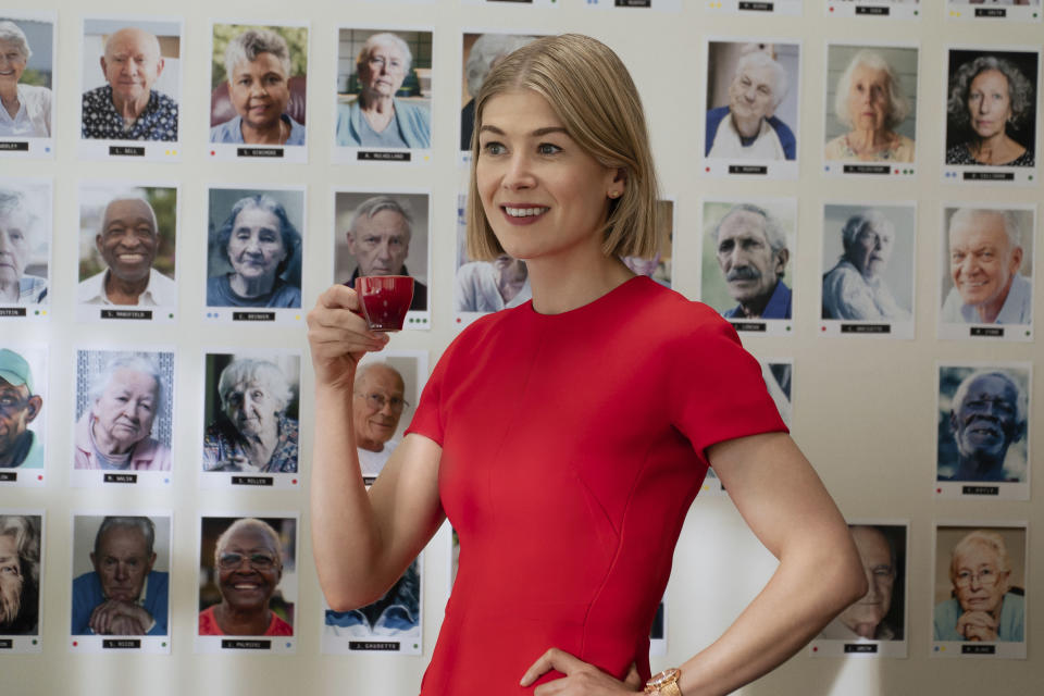 "This image released by Netflix shows Rosamund Pike in a scene from ""I Care A Lot."" Pike accepted the award for best actress in a motion picture, musical or comedy at the Golden Globe Awards on Sunday, Feb. 28, 2021. (Seacia Pavao/Netflix via AP)"