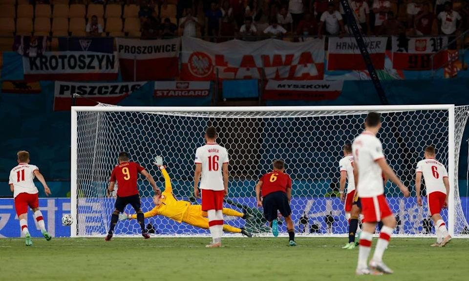 Spain's Gerard Moreno (second left) watches as his penalty comes back off the post.