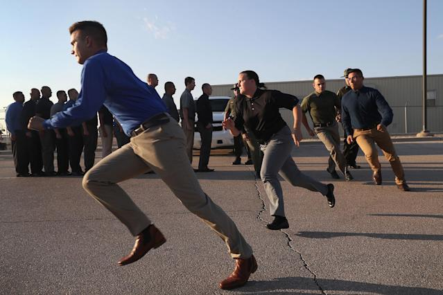 <p>U.S. Border Patrol trainees run upon their initial arrival to the U.S. Border Patrol Academy on August 2, 2017 in Artesia, N.M. (Photo: John Moore/Getty Images) </p>