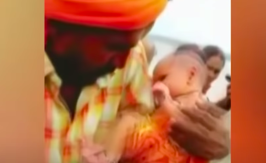 A boatman in Uttar Pradesh became a local star when he brought home an abandoned 21-day-old girl child he had found near the banks of river Ganges. The local authorities have taken the infant to a hospital and doctors are monitoring her health (Hindustan Times YouTube/Screengrab)