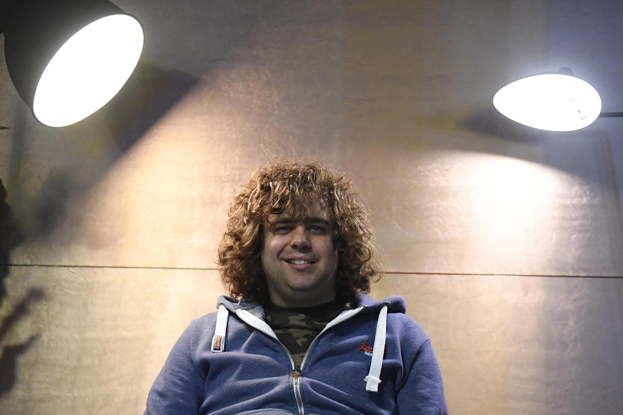 British singer Daniel Wakeford, who is autistic, poses during a photo session at Le Liberte music hall in Rennes on December 9, 2017, on the sidelines of the 39th edition of the Trans Musicales music festival. Diagnosed with autism at age 9, Daniel Wakeford has been writing and recording songs since he was 22 years old. Supported by Carousel, an organization that helps artists with learning disabilities, he has accumulated an impressive repertoire of tracks. On television and music stages in Britain, he has become a star thanks to his pop songs. / AFP PHOTO / DAMIEN MEYER        (Photo credit should read DAMIEN MEYER/AFP via Getty Images)
