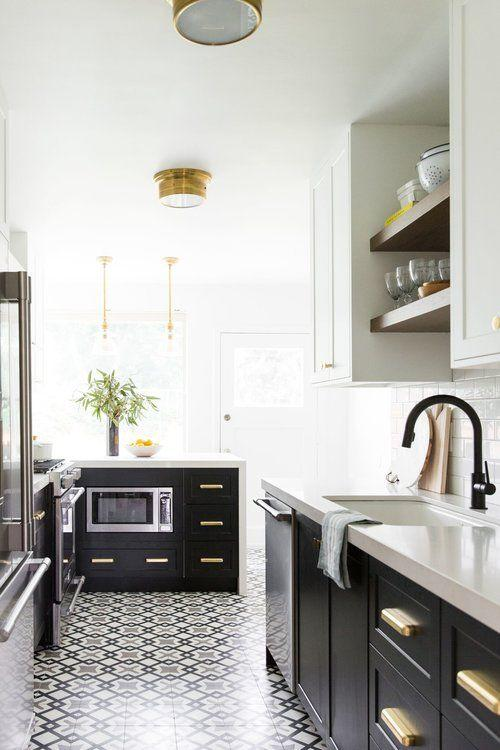 """<p>Another way to reduce that hallway feeling is to break up your materials. Here, a patterned floor and dark base cabinets ground the space, while the upper cabinets in a lighter color draw the eye up toward the ceiling.<br></p><p><strong>See more at <a href=""""https://www.studio-mcgee.com/portfolio/2017/8/3/hillside-kitchen-remodel"""" target=""""_blank"""">Studio McGee</a>. </strong></p>"""
