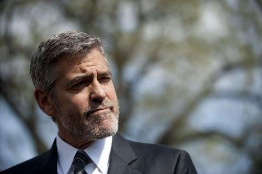 US actor George Clooney speaks at the White House after a meeting with US President Barack Obama