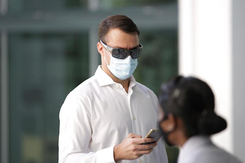 Perry Scott walking into State Courts on 2 June. (PHOTOS: Dhany Osman / Yahoo News Singapore)