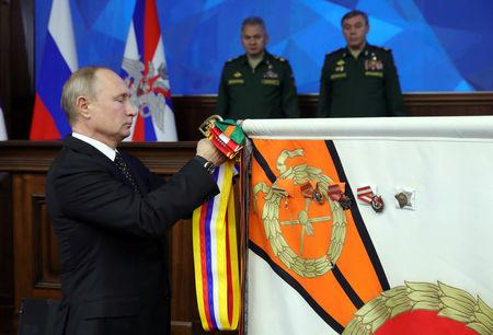 Russian President Vladimir Putin takes part in a ceremony to present the Order of Suvorov to the Eastern Military District during a meeting of Russia's Defence Ministry Board in Moscow, Russia December 18, 2018. Sputnik/Mikhail Klimentyev/Kremlin via REUTERS