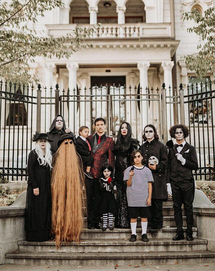 """<p>With so many altogether ooky characters to choose from, the Addams Family is great costume concept for extra-large groups. </p><p><strong>See more at <a href=""""https://www.instagram.com/p/CHA_HD5gpis/"""" rel=""""nofollow noopener"""" target=""""_blank"""" data-ylk=""""slk:@hannahmcfallphotography"""" class=""""link rapid-noclick-resp"""">@hannahmcfallphotography</a>. </strong></p><p><a class=""""link rapid-noclick-resp"""" href=""""https://www.amazon.com/Inch-Long-Creature-Brown-HM-1133/dp/B07PVQM7B3/ref=sr_1_2?dchild=1&tag=syn-yahoo-20&ascsubtag=%5Bartid%7C10050.g.32906192%5Bsrc%7Cyahoo-us"""" rel=""""nofollow noopener"""" target=""""_blank"""" data-ylk=""""slk:Shop Cousin It Costume"""">Shop Cousin It Costume</a><br></p>"""