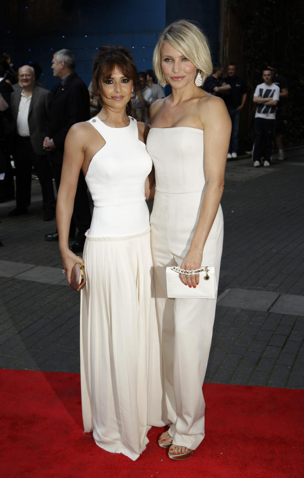 British singer Cheryl Cole, left, and U.S. actress Cameron Diaz pose for photographers as they arrive for the European premiere of the movie 'What to Expect When You're Expecting' at a cinema in London, Tuesday, May 22, 2012. (AP Photo/Matt Dunham)
