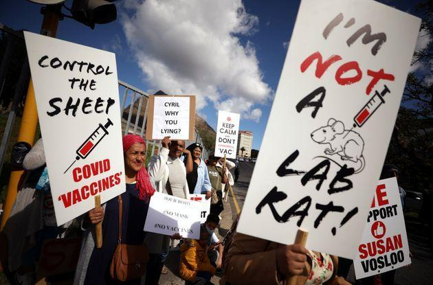 Anti-vaccine protestors hold placards a day after the country opened COVID-19 vaccinations for everyone 18 years old and above, outside Groote Schuur hospital in Cape Town, South Africa, on Aug. 21, 2021. (Photo: Mike Hutchings via Reuters)