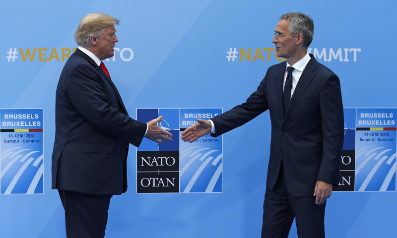 U.S. President Donald Trump is greeted by NATO Secretary General Jens Stoltenberg before a summit of heads of state and government at NATO headquarters in Brussels on Wednesday, July 11, 2018. NATO leaders gather in Brussels for a two-day summit to discuss Russia, Iraq and their mission in Afghanistan. (AP Photo/Francois Mori)