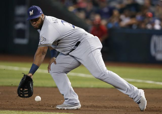 FILE - In this Sunday, July 21, 2019, file photo, Milwaukee Brewers first baseman Jess Aguilar goes after a grounder during the sixth inning of a baseball game against the Arizona Diamondbacks in Phoenix. The Miami Marlins claimed Aguilar off waivers, Monday, Dec. 2, 2019, after he was designated for assignment the week before by the Tampa Bay Rays. (AP Photo/Ross D. Franklin, File)