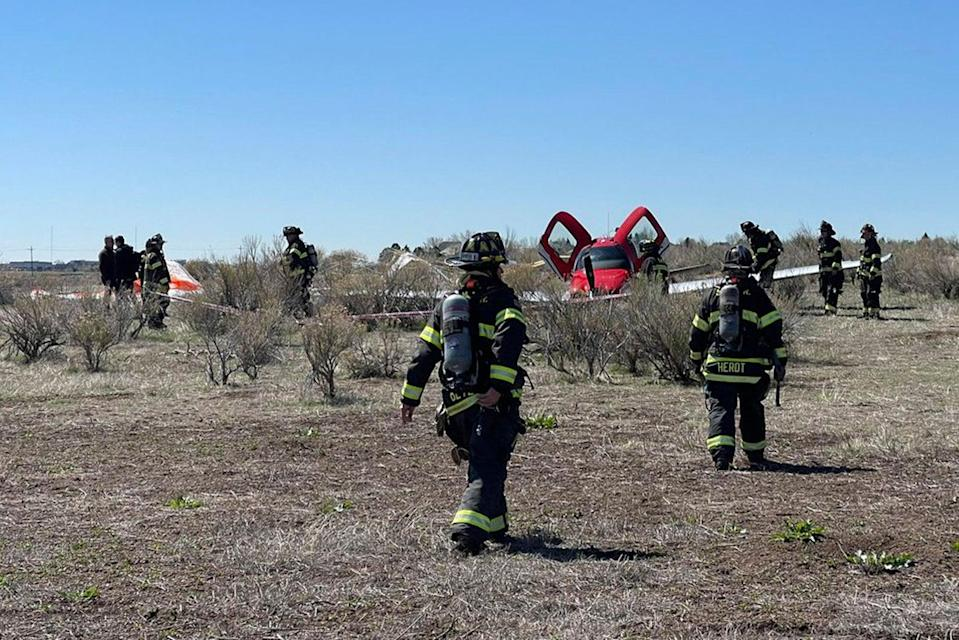 <p>In this photo provided by South Metro Fire Rescue, emergency personnel work at the scene where a single engine plane landed after a mid-air collision near Denver, Wednesday, 12 May 2021. Federal officials say two airplanes collided but that there are no injuries</p> (AP)