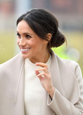 <p>Dubbed the queen of the bun, Meghan surprised royal fans by wearing her go-to messy bun once more (despite criticism from the public) on her debut trip to Belfast. (Photo: Getty Images) </p>