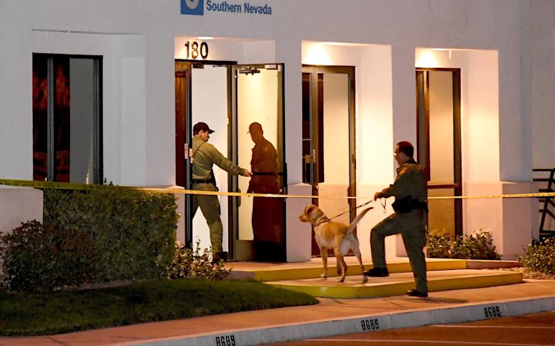 Las Vegas Metropolitan Police Department K-9 officers search the Jewish Community Center of Southern Nevada after an employee received a suspicious phone call that led about 10 people to evacuate the building - 2017 Getty Images