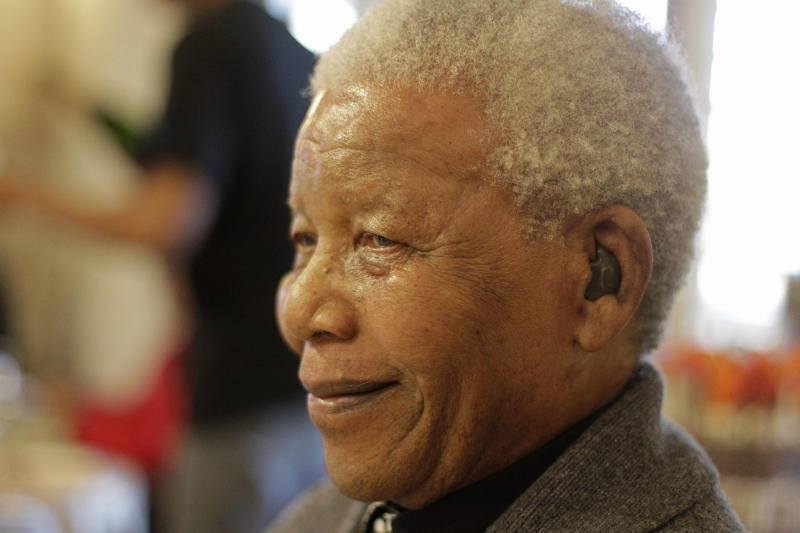 Former South African President Nelson Mandela as he celebrates his birthday in Qunu, South Africa, Wednesday, July 18, 2012. Across the country, and even abroad, people are doing good deeds to honor the country's most famous statesman on his 94th birthday Wednesday.(AP Photo/Schalk van Zuydam)
