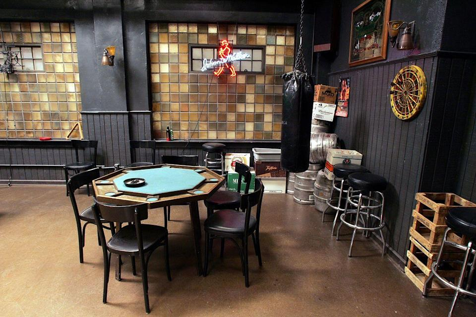 <p>Many conversations—and fights—happened at the famous game table. To ease any tension, there was always the punching bag.</p>