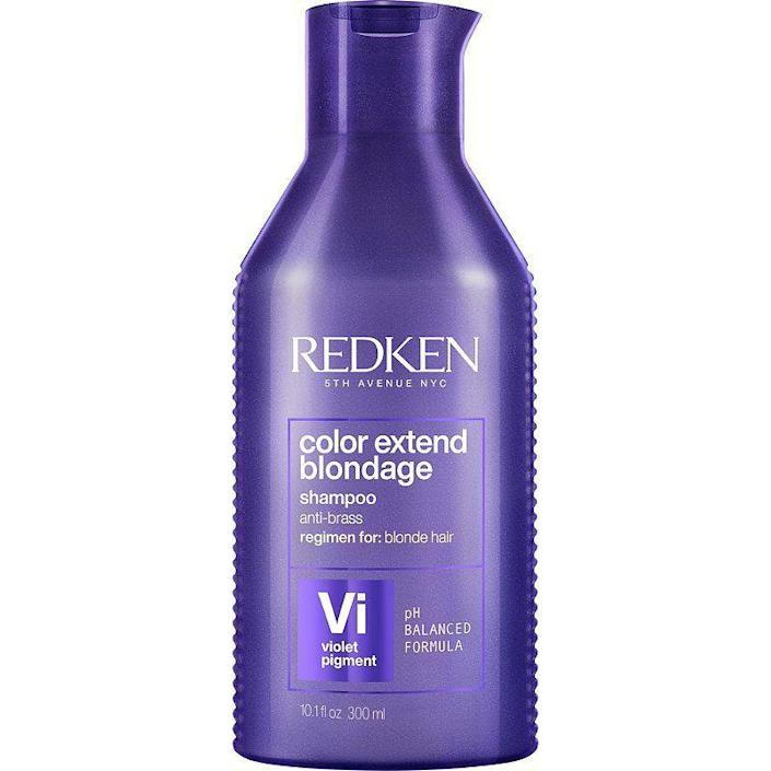 """<p><strong>REDKEN</strong></p><p>amazon.com</p><p><strong>$23.00</strong></p><p><a href=""""https://www.amazon.com/dp/B08SSGQJS7?tag=syn-yahoo-20&ascsubtag=%5Bartid%7C10051.g.36740831%5Bsrc%7Cyahoo-us"""" rel=""""nofollow noopener"""" target=""""_blank"""" data-ylk=""""slk:Shop Now"""" class=""""link rapid-noclick-resp"""">Shop Now</a></p><p>So you've decided to be braver than me and become a blonde. Congratulations! To keep those locks icy rather than spray-tan-gone-bad orange, this purple shampoo gets rid of yucky brass tones for look that says, """"I just left the salon ten minutes ago.""""</p>"""