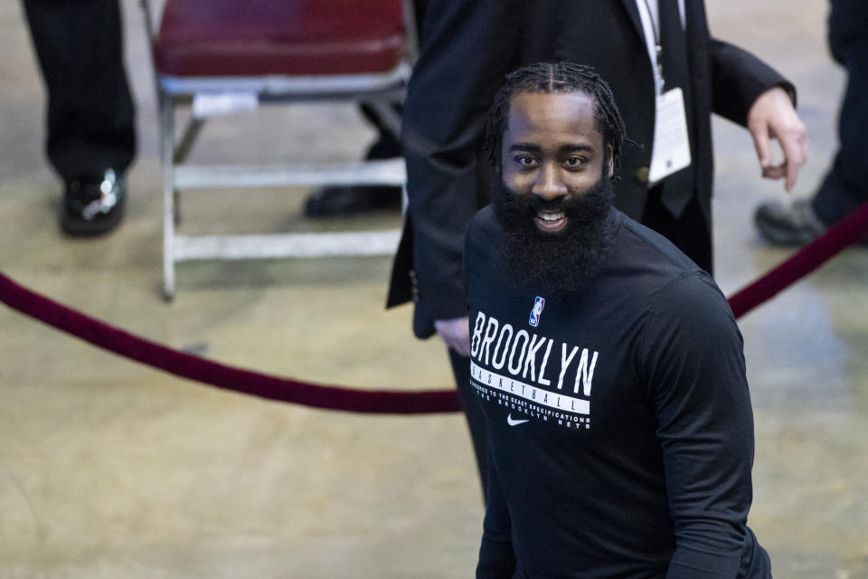 Brooklyn Nets guard James Harden (13) smiles at a group of fans after he finishes warming up before an NBA basketball game against the Houston Rockets, Wednesday, March 3, 2021 in Houston. (Mark Mulligan/Houston Chronicle via AP)