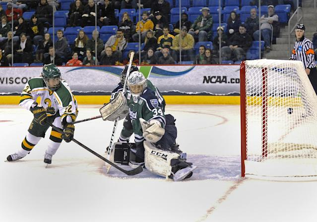 Clarkson's Christine Lambert, left, watches her shot go past Mercyhurst goaltender Amanda Makela during the second period in an NCAA college hockey game in the semifinals of the women's Frozen Four in Hamden, Conn., Friday, March 21, 2014. (AP Photo/Fred Beckham)