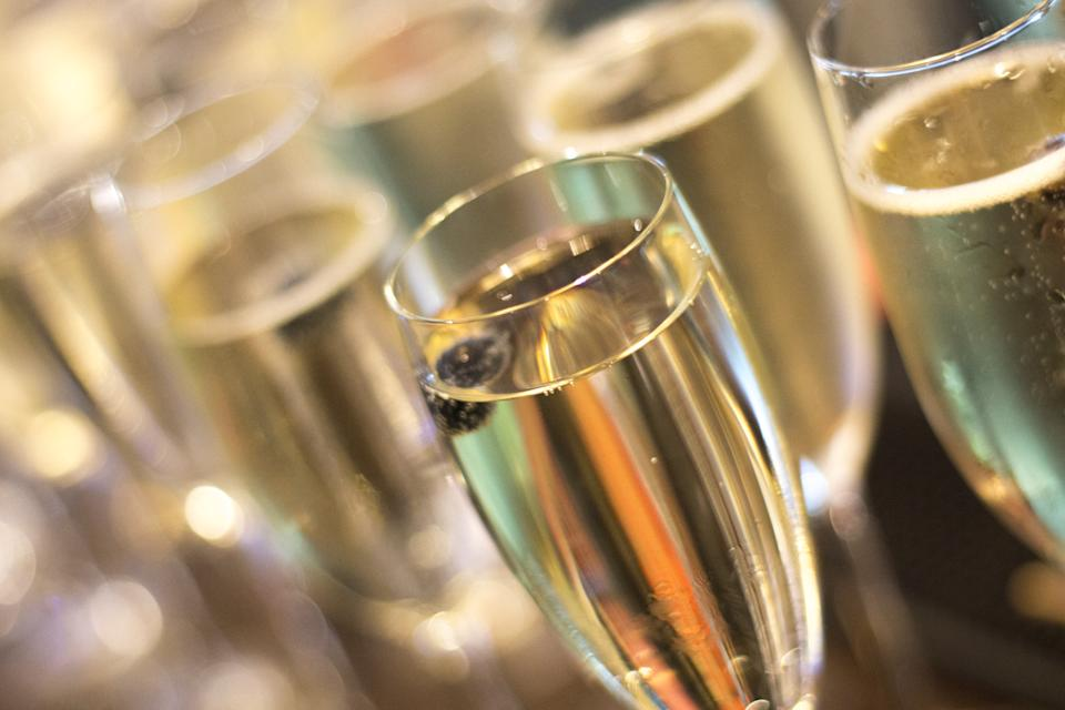 Champagne sparkling white wine glasses in restaurant bar in wedding reception party photo.