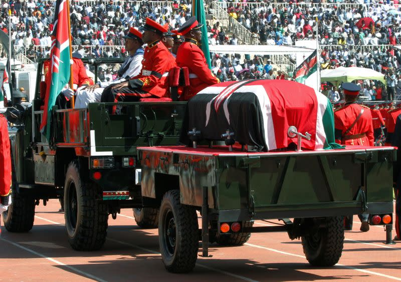 Military officers escort a gun carriage carrying the coffin of late former Kenya's President Daniel Arap Moi, draped in the national flag, during a state funeral procession to the Nyayo Stadium, the venue of the national memorial service in Nairobi