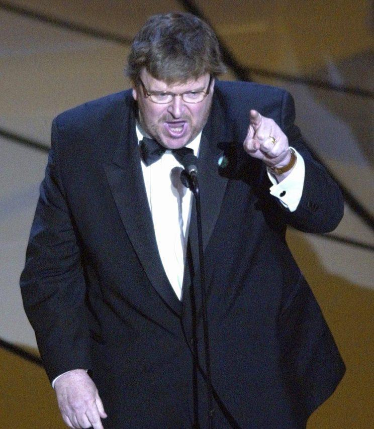 "Michael Moore accepting the Oscar for best documentary feature for ""Bowling for Columbine"" on March 23, 2003 (Photo: Kevork Djansezian/AP)<br>"