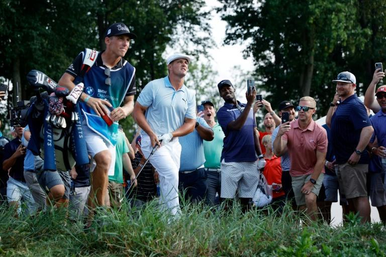 Off target: American Bryson DeChambeau plays out of the rough on the way to a five-under par 67 and a share of the third-round lead in the US PGA Tour BMW Championship (AFP/Tim Nwachukwu)