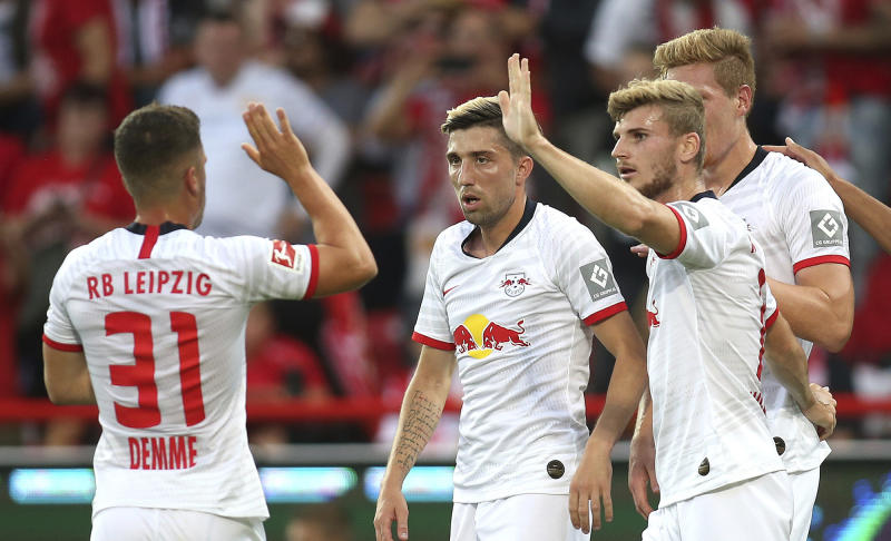 From left, Leipzig's Diego Demme, Kevin Kampl, Timo Werner, Marcel Halstenberg celebrate a goal, during the German Bundesliga soccer match between Union Berlin and RB Leipzig, in Berlin, Sunday, Aug. 18, 2019. (Andreas Gora/dpa via AP)