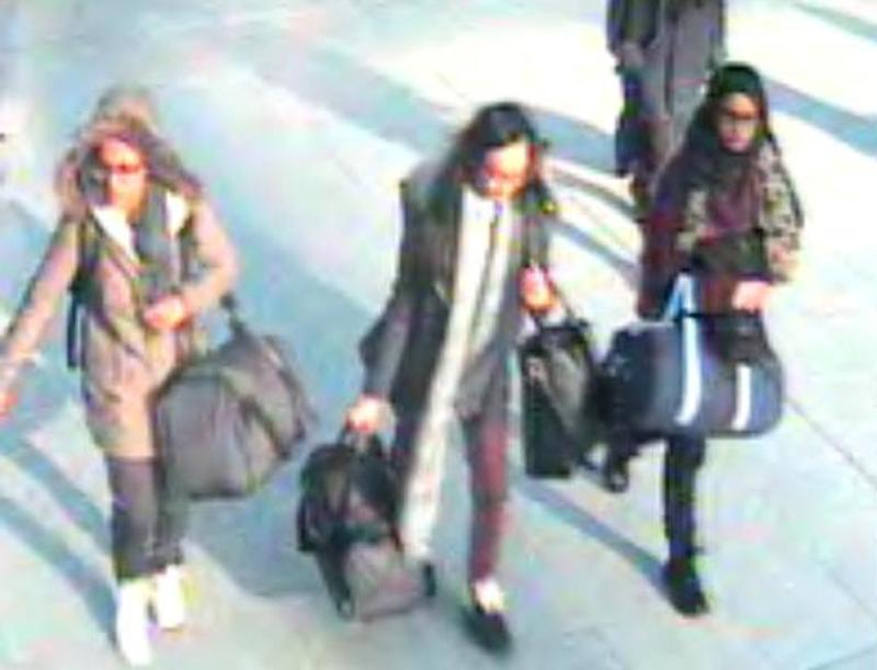 A CCTV image received by London's Metropolitan Police (MPS) on February 23, 2015 shows (L-R) British teenagers Amira Abase, Kadiza Sultana and Shamima Begum with their luggage at Gatwick Airport, south of London