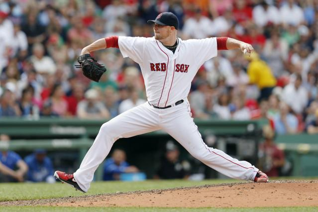 FILE - In this July 20, 2014, file photo, Boston Red Sox's Jon Lester pitches during the eighth inning of a baseball game against the Kansas City Royals, in Boston. A person with knowledge of the trade says the Athletics have won the Jon Lester sweepstakes, acquiring the left-hander along with outfielder Jonny Gomes from the Red Sox for slugging outfielder Yoenis Cespedes before Thursday's, July 31, 2014, trade deadline. The person spoke on condition of anonymity because neither club announced the deal.(AP Photo/Michael Dwyer, File)