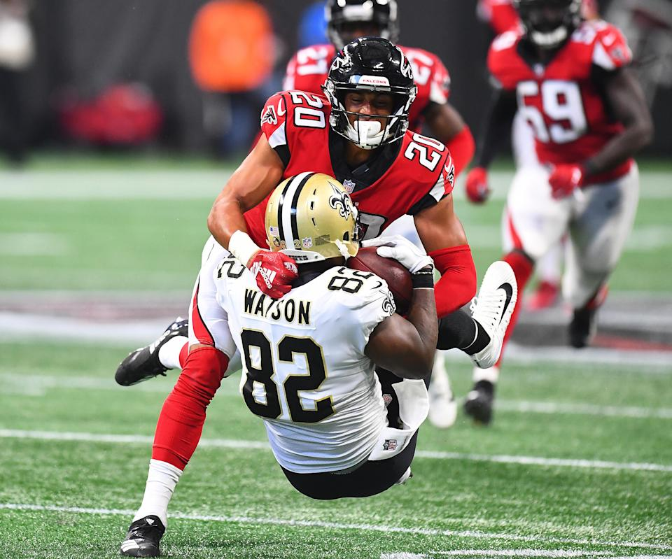 <p>Benjamin Watson #82 of the New Orleans Saints is tackled by Isaiah Oliver #20 of the Atlanta Falcons during the third quarter at Mercedes-Benz Stadium on September 23, 2018 in Atlanta, Georgia. (Photo by Scott Cunningham/Getty Images) </p>