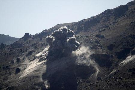 File photo of smoke billowing from a military arms depot after it was hit by a Saudi-led air strike on the Nuqom Mountain overlooking Yemen's capital Sanaa