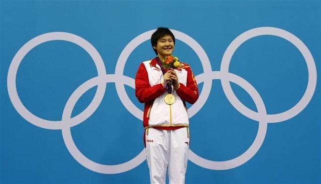 Olympic sensation Ye Shiwen hit back at a top American coach who suggested the Chinese swimmer could be using banned substances, telling state news agency Xinhua that John Leonard had acted unprofessionally. China's Ye Shiwen poses with her gold medal during the women's 400m individual medley victory ceremony at the London 2012 Olympic Games at the Aquatics Centre July 28, 2012. Ye smashed the world record to win the gold medal with a time of four minutes 28.43 seconds.