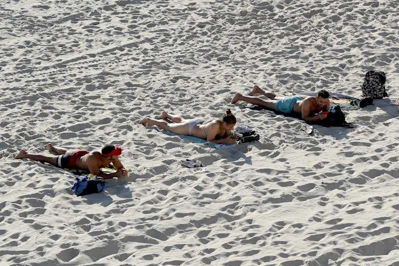 Picture of people adhering to social distancing rules at Cottesloe Beach in Perth. Domestic travel may soon be possible within Australia