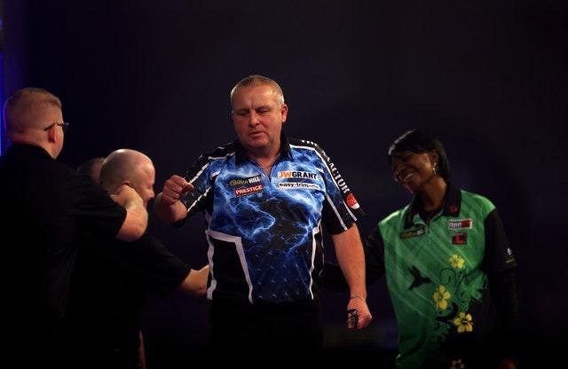Andy Boulton celebrates his win over Deta Hedman at the WilliamHill PDC World Darts Championship
