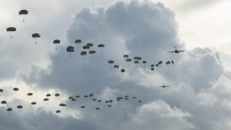 US Army paratroopers jump over Guam from US Air Force C-17 airlift planes