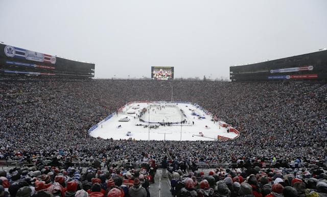 The Detroit Red Wings and the Toronto Maple Leafs skate during the third period of the Winter Classic outdoor NHL hockey game at Michigan Stadium in Ann Arbor, Mich., Wednesday, Jan. 1, 2014. (AP Photo/Carlos Osorio)