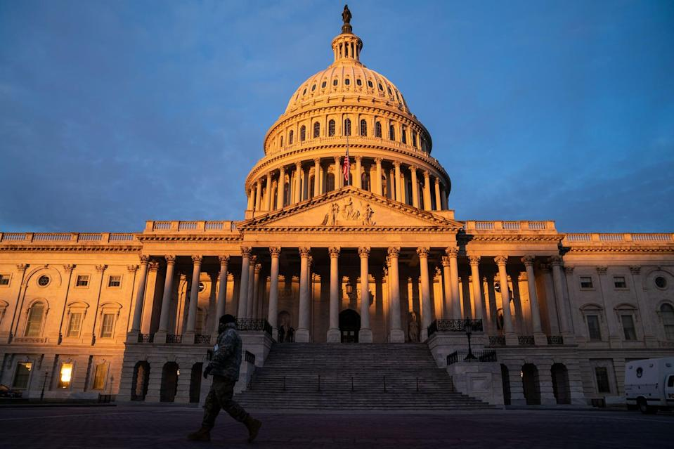 WASHINGTON, DC - JANUARY 11: The sun rises on the  U.S. Capitol Building, where heightened security measures are in place nearly a week after a pro-Trump insurrectionist mob breached the security of the nations capitol while Congress voted to certify the 2020 Election Results on Monday, Jan. 11, 2021 in Washington, DC. (Kent Nishimura / Los Angeles Times via Getty Images)