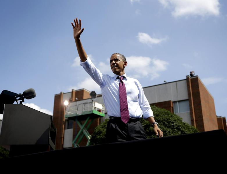 President Barack Obama waves to supporter from the stage after speaking at a campaign event at Norfolk State University, Tuesday, Sept. 4, 2012, in Norfolk, Va. (AP Photo/Pablo Martinez Monsivais)