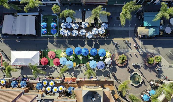 An aerial view of outdoor dining as restaurants moved onto Main Street in Huntington Beach.