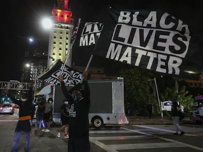 <p>Black Lives Matter protestors celebrating Joe Biden's win as 46th US President in Miami, Florida, 7 November</p> (Getty Images)