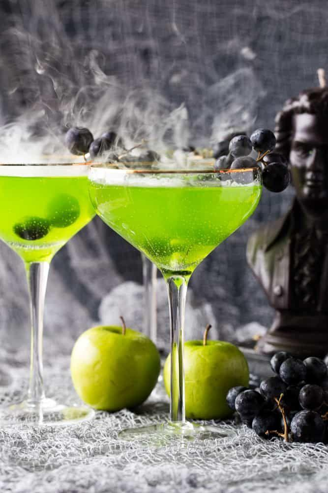 """<p>This vibrant green cocktail deserves a spot on your Halloween party menu. It's crisp, tart, and scary-good! </p><p><strong>Get the recipe at <a href=""""https://theseasidebaker.com/poison-apple-halloween-cocktail/"""" rel=""""nofollow noopener"""" target=""""_blank"""" data-ylk=""""slk:The Seaside Baker"""" class=""""link rapid-noclick-resp"""">The Seaside Baker</a>. </strong></p><p><a class=""""link rapid-noclick-resp"""" href=""""https://go.redirectingat.com?id=74968X1596630&url=https%3A%2F%2Fwww.walmart.com%2Fsearch%2F%3Fquery%3Dice%2Btray&sref=https%3A%2F%2Fwww.thepioneerwoman.com%2Fholidays-celebrations%2Fg36982659%2Fhalloween-drink-recipes%2F"""" rel=""""nofollow noopener"""" target=""""_blank"""" data-ylk=""""slk:SHOP ICE TRAYS"""">SHOP ICE TRAYS</a></p>"""