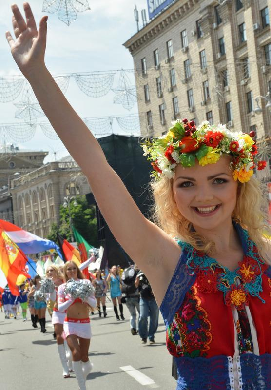 A girl waves her hand as she takes part in a parade at the Euro 2012 football championsships fan zone in Kiev during it official opening on June 8, 2012, few hours before the Euro 2012 football championships opening. AFP PHOTO/ SERGEI SUPINSKYSERGEI SUPINSKY/AFP/GettyImages